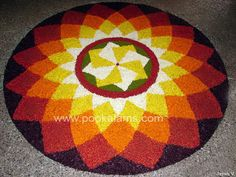 Onam Festival lasts for ten days and brings out the best of Kerala culture.View these 50 Best Pookalam Indian Floral Design and get your creative side going. Best Rangoli Design, Indian Rangoli Designs, Rangoli Designs Flower, Small Rangoli Design, Flower Rangoli, Beautiful Rangoli Designs, Kolam Designs, 3d Rangoli, Rangoli Colours
