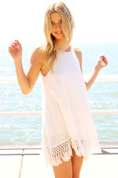 White Sleeveless High Neckline Dress with Knotted Tassel Hem