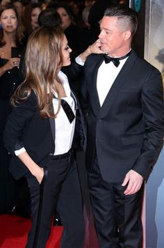 Not only did Angelina Jolie and Brad Pitt wear matching outfits at the EE British Academy Film Awards in London on Feb. 16, 2014, the duo couldn't stop showing their love on the red carpet either. Angie even fixed her man's bow tie. Mush factor: 10.