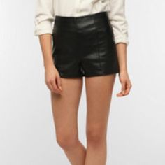 NEW Urban Outfitters Faux Leather Shorts Urban Outfitters Highwaisted Faux Leather Shorts. Size 2. Never worn! Brand new condition without tags. Zipper back detail. High waisted style. Brand is sparkle and fade. Urban Outfitters Shorts