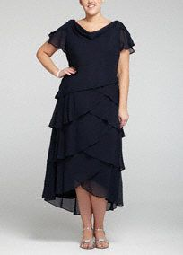 Be the picture of perfection in this stunning draped neck dress! Short sleeve bodice features classy and eye-catching draped neck detail. Multi-tiered bottom creates dimension and a slimming silhouette. Fully lined. Back zip. Imported polyester. Dry clean. A fabric design element that features multiple layers.