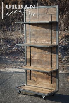 This industrial style shelving unit is the perfect piece to display merchandise, books, or just about anything else. This tough display is made from distressed reclaimed pine, waxed raw steel banding, Metal Furniture, Industrial Furniture, Industrial Style, Diy Furniture, Furniture Plans, Industrial Living, Industrial Farmhouse, Industrial Design, Industrial Stairs