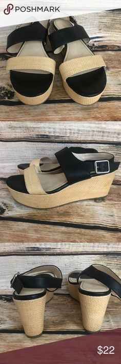 """Calvin Klein Lorianne Wedge Sandals Sz 9.5 Style: Lorianne Calf/Raffia Color: Black/Natural Condition: Pre owned, good condition, but does show some wear on the front and toe area. Some scratches in the leather and in the raffia Details: Leather/raffia upper. Open toe. Raffia strap across toe. Adjustable strap with buckle closure. Buckle with Calvin Klein name on it. Leather lining. Cushioned insole.  Signatured rubber outsole. 1 1/2"""" raffia platform, 3"""" wedge heel. insole approx. 10""""…"""
