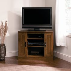 """Features:  -Corner TV stand.  -Two adjustable shelves hold audio and video equipment.  -Made in USA.  TV Size Accommodated: -37"""".  Product Type: -TV Stand.  Design: -Enclosed storage.  Finish: -Abbey"""
