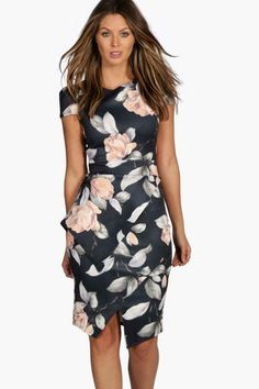 $20 boohoo Misty Asymmetric Peplum Floral Print Midi Dress. Get dance floor-ready in an entrance-making evening dress. Look knock-out on nights out in figure-skimming bodycon fits, flowing maxi lengths and stunning sequin-embellished occasion dresses. #ad #ShopStyle #boohoo #fashion #style #workoutfit #officeoutfit