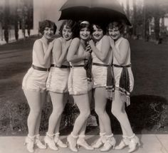 """Five flappers, one umbrella. Clara Bow (at age 22) for """"Rough House Rosie, 1927 (via clarabowarchive on Tumblr)"""