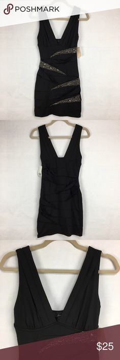 NWT black dress with beading Black dress with beading. Material folds over and has beading on some. Forever 21 size small. 89% polyester 11% spandex. New with tags. Forever 21 Dresses Mini