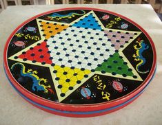 I remember this, my Parents, brother and I played this Vintage Chinese Checkers Game Board Metal Chinese Checkers Round Tin circa 1960