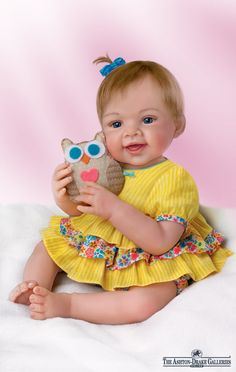 Isn't she a hoot? This lifelike baby girl by Master Doll Artist Waltraud Hanl is 18-inches of pure sweetness!