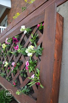 diy vertical flower bed by the idea room  Drill hole in top & can be watered from top to reach the bottom of flowers.