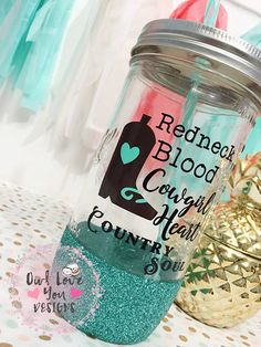 This comes with one glitter dipped Tumbler, The quote/design reads Redneck Blood, Cowgirl Heart, Country Soul. This has a beautiful glitter dipped effect, and can be personalized to any color your heart desires. Let's work on designing your own custom Tumbler.  *ORDERING INSTRUCTIONS* At checkout add to notes: 1-Colors of Quote/Images 1-Color of Glitter  Comes With: 1- 24oz Mason Jar 1- Vinyl Design 1- BPA FREE straw  Upgrade your straw with a design on it…