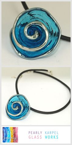 This blue spiral pendant necklace is an original piece of lampwork jewelry. The blue pendant is made purely out of glass. The necklace is a piece of statement Jewelry. This unique bead is handmade by me and will make a wonderful gift for her under 20 Dollars.