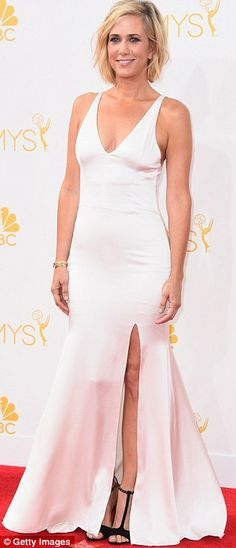 Kristen Wiig sported a sleeveless white number and black heels at the 2014 Emmys http://dailym.ai/1lufdYb