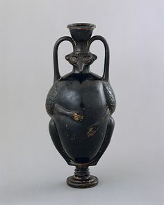 Terracotta amphoriskos (flask) in the form of a bird-man Period: Classical Date: late 5th century B.C. Culture: Greek, Attic Medium: Terracotta; black-glaze Dimensions: Overall: 7 x 3 1/4 in. (17.8 x 8.3 cm) Classification: Vases Credit Line: Purchase, Mr. and Mrs. Christos G. Bastis Gift, 1999 Accession Number: 1999.68