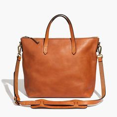 """You asked for it: We remade our signature ruggedly cool carryall in a zip-top version. Not too big, not too small, it's designed to sling over your shoulder using the removable crossbody strap (aka a sized-down take on our regular tote). Figure in the secure top zip and it's the ideal bag for your daily commute. Please note: As leather is a natural material, each bag varies slightly in texture and color. We love the way each tote wears in differently, taking on a special character all its own. ¿¿<ul><li>Leather.</li><li>Zip closure.</li><li>Interior zip pocket, interior pocket.</li><li>4 3/10"""" handle drop.</li><li>11 4/5""""H x 15 2/5""""W x 5 1/2""""D.</li><li>Import.</li></ul>"""