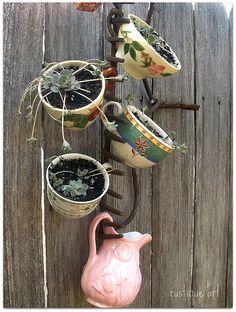 Fun repurposed rake projects like this rake plant holder