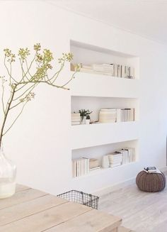 "I love the clean feel of the niches instead of a large book case in this particular space. Feels very minimalist in a ""traditional"" kind of way"