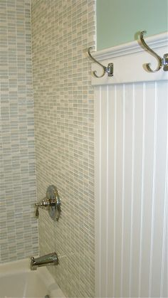 tile to wall transition, plus hooks for towels. master bath.