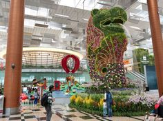 SINGAPORE LAND IN AN AIRPORT YOU WONT WANT TO LEAVE Singapores Changi International Airport (truly, the best-run airport in the world) is not only clean and efficient, its packed with perks you wouldnt expect to find in an airport—and that might make you not want to leave. It has a butterfly garden, a swimming pool, a gym, a spa, a movie theater, an arcade, a playground, and free tours of the city for those with a layover of five or more hours. (AGREED!!!)