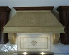 Just wood w/ waxed Venetian plaster. Hood relief design borrowed from tile motif inset
