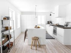 Big bright kitchen. Love the floor, the subway tile, the white cabinets, and the black and white rug.