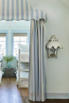 ASHLEY GILBREATH INTERIOR DESIGN: Blue and white cabana stripe canopy and drapery and a pagoda sconces create a fun entrance to this Rosemary Beach bunk room. Ashley Gilbreath, Rosemary Beach, Cabana, Canopy, Sconces, Blue And White, Cottage, Interior Design, Drapery