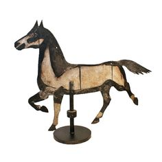Black and white painted iron weathervane horse from an important Midwestern folk art collection. c. 1890