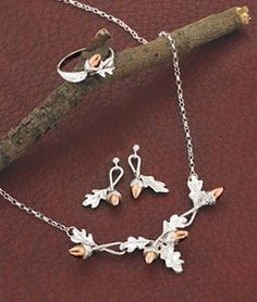 """Oak Leaf Jewelry EXCLUSIVE! The oak is the most revered of all trees - a symbol of strength and energy, its acorns a sign of great things to come. Make great things happen with this notable jewelry suite. Delicate sterling silver oak leaves and 9k rose gold acorns are more beautiful than the tree itself. Necklet adjusts from 16-18"""". Ring in whole sizes 5-10. Made in a small family workshop in Oban, Scotland."""
