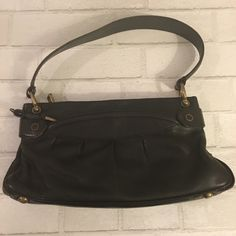 Original Marc Jacobs Collection Black handbag 100% authentic. In perfect condition. No damage, scratches or marks. Kept in dust bag. Hidden umbrella storage underneath handbag. Price is Firm Unless Bundled. 10% Off 2 Item 15% Off 3 Items or More Marc Jacobs Bags Shoulder Bags
