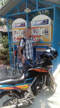 Buying fuel for your motorbike...Thai self serve style.