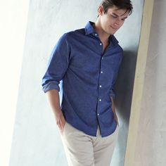 Stay classic in a button-front shirt and tan khakis.