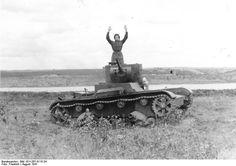 Russian tanker surrendering his T-26 light tank, Aug 1941