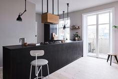 Reform's IKEA kitchen by Norm Architects. A design in sawn smoked oak with handles in tombac.