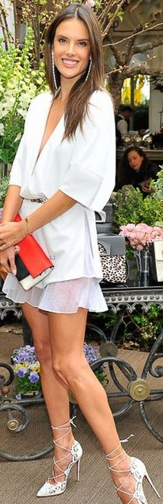 Alessandra Ambrosio: Purse and shoes – Christian Louboutin  Romper – Sally LaPointe  Earrings – AS29 by Audrey Savransky