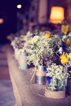 Rustic decor Tin Cans wrapped in Twine and filled with wild flowers | Budget Friendly DIY Decor | Rustic Barn Wedding at Lyde Court in Wales. | Image by Jessica Raphael Photography | http://www.rockmywedding.co.uk/laura-andy-2/
