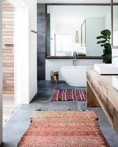 Bath or shower, doesn't matter — these bathrooms are heavenly. 😇