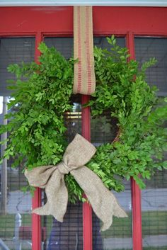 couldn't be simpler.stick in boxwood. Garnish with silver bells, acorns or pinecones All Things Christmas, Christmas Time, Christmas Wreaths, Christmas Crafts, Christmas Decorations, Xmas, Christmas Garden, Wall Decorations, Holiday Decorating