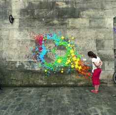 Based in Paris, Mademoiselle Maurice creates colorful installations on the street by conglomerating a bunch of origami.