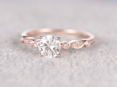 Moissanite Engagement ring,14K&18K Rose/Yellow/White Gold Available. Every Jewelry in my store needs making to order. If you have the stone,you can ask us custom making the ring setting! [Item details] Engagement Ring: Solid 14K Rose Gold(Can be made in white/yellow/rose gold) Band Width approx 1.5mm Size 5#(Ring can be resized) 5mm Round cut 0.5ctw Charles & Colvard Moissanite 0.26ctw Round Cut SI-H Natural Conflict free diamonds Prong,Bezel Set Estimated Retail Price: $1800 ------ ...