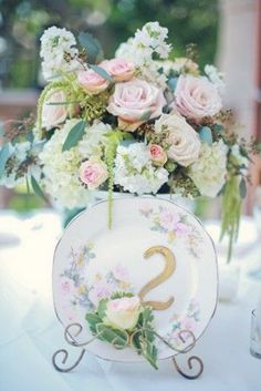These beautiful floral plates would be the perfect table numbers for a vintage wedding.     Image via  Elizabeth Anne Designs .