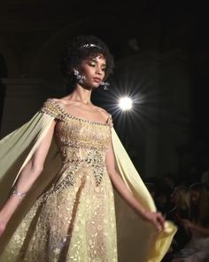 Golden Embroidered A-Lane Evening Maxi Dress / Evening Gown with a Cape. Runway Show by Georges Hobeika Couture Fashion, Runway Fashion, Kawaii Dress, Golden Dress, Fantasy Gowns, High Fashion Dresses, Gowns With Sleeves, Couture Collection, Beautiful Gowns