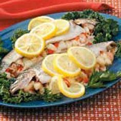 Seafood-Stuffed Rainbow Trout Recipe -This is a special way to serve fresh rainbow trout, stuffed with a mixture of scallops, shrimp, rice, bacon and vegetables. But don't wait for a special occasion to serve it—it's easy to put together and put in the oven.