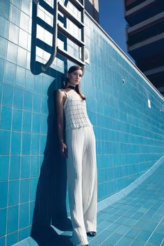 "Vassiliki Charitou's collection ""The flow"" is inspired by the decade of and is defined by pleated fabrics and window pane patterns. Ancient Greek Sculpture, Pleated Fabric, Spring Summer 2016, Ss16, Short, Braided Hairstyles, Flow, Women Wear, White Dress"