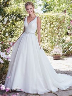 Rebecca Ingram - KAREN, This sweet Ines Organza ballgown features a pleated bodice, dazzling bead and Swarovski crystal belt, and pockets. Simple straps glide from V-neckline to V-back. Finished with covered buttons over zipper and inner elastic closure.