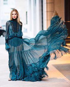 Fleeting Romance - @chiaraferragni in a #RobertoCavalliFW16 petrol blue chiffon dress with military flogging closures. #ChiaraFerragni #CavalliCat #CavalliGirl #MFW Ph. @timuremek_photography