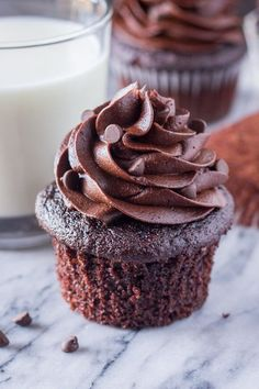 Double Chocolate Cupcakes made with sour cream and cocoa for a super soft, fluffy, moist texture and rich chocolate taste. Topped with chocolate frosting.