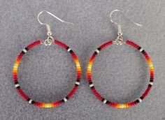 """Made by Rita, Mi'kmaq Indian of the Gesgapegiag Mi'kmaq tribe. Red Sunburst Beaded Silver Hoop Earrings. in Red with Sunburst Colors in colors black, Red, orange, yellow and white. Earring Hoop is 1.5"""".   eBay!"""