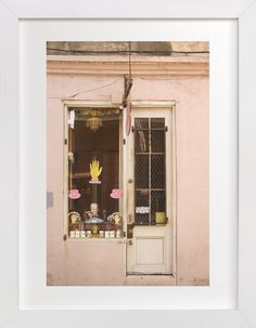 """""""New Orleans French Quarter Pink Facade"""" - Art Print by Kathy Van Torne in beautiful frame options and a variety of sizes."""