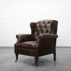 Wingback Leather Armchair  In historic times these are often used near a fireplace. Today, these chairs work beautifully as stylized accent pieces in a room, whether living, study or a bedroom. Each chair is handcrafted of the finest leather and comes with a comfortable seat cushion.