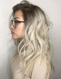 Messy Silver Hair With Brown Roots